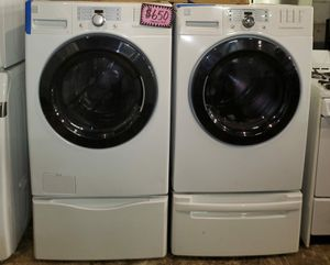 Kenmore front load washer and dryer set with pedestal working perfectly 4 months warranty for Sale in Baltimore, MD
