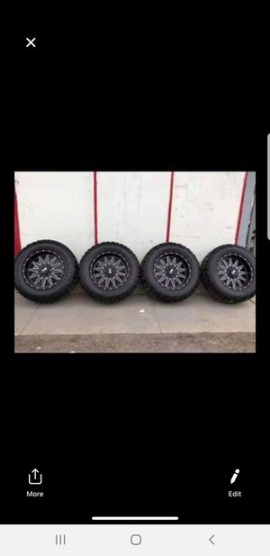 Chevy rims and tires 20x10 with 35x12.50 20 for Sale in Phoenix, AZ