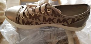 Size 9M Michael Kors goldtone sneakers with MK Logo for Sale in Baltimore, MD