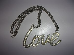 Love necklace huge rhinestone pendant on dog chain 1990s bling jewelry for Sale in Greenville, SC