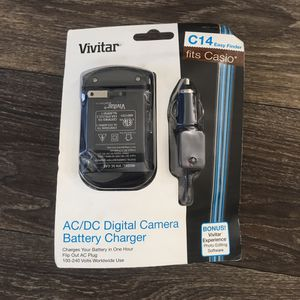 Vivitar AC/DC Digital camera battery charger. New. Open box. Retail box is Distressed. for Sale in Mauldin, SC