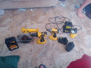 18 volt Dewalt set impact driver drill circular saw flashlight 2 batteries to Chargers box of drill bits batteries and chargers are fairly new for Sale in Saginaw, MI