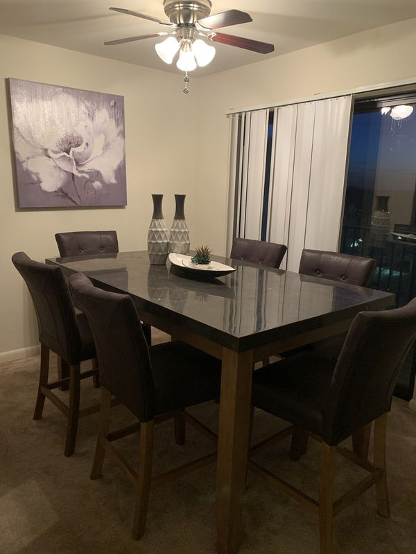 Gorgeous granite dining room table with six chairs