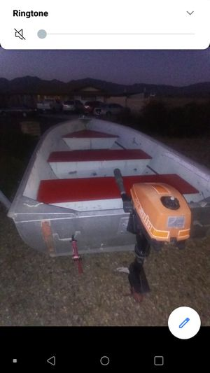 12 foot aluminum fishing boat. Lake ready with 4 horse power out board motor. for Sale in Hemet, CA