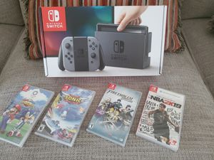 NINTENDO SWITCH + 4 PREMIUM GAMES (NEW) NO TRADES for Sale in Kissimmee, FL
