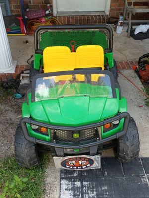12 volt 2 speed John Deere Gator with a bed that can be raised to empty your haul and the tailgate unlocks and folds down for better efficiency. for Sale in Niceville, FL