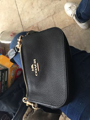 Coach black leather cross over clutch for Sale in Las Vegas, NV