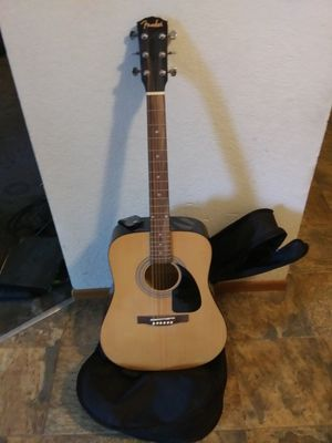 Fender model FA-100 acoustic guitar. with back pack case plays great and stand for Sale in Marysville, WA
