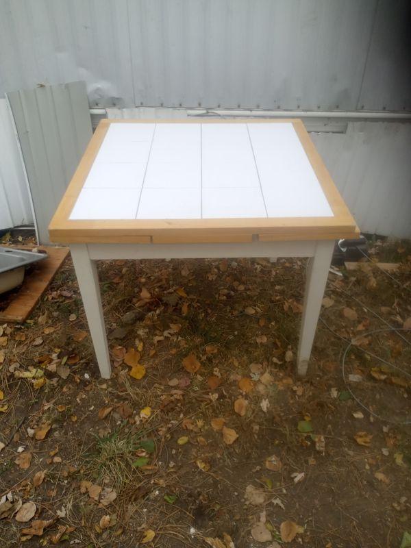 Homemade kitchen table, ceramic tile top.
