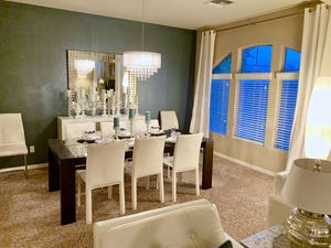 Z Gallerie Dining Table w/ 6 cream leather chairs beautiful set downsizing for Sale in Sun City, AZ