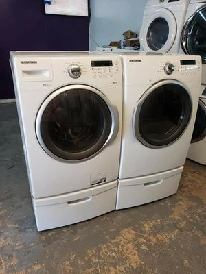 Samsung front loads washer and dryer electric with pedestals for Sale in Stafford, TX