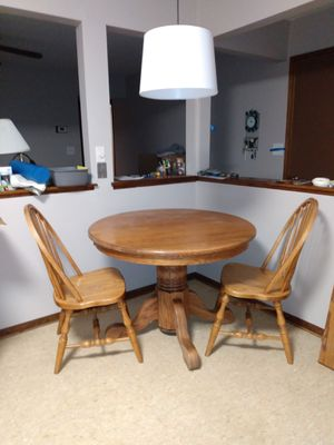 Round pedastal table with 2 chairs for Sale in Fort Wayne, IN