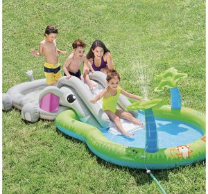 Intex elephant slide inflatable pool with palm tree sprinklers for Sale in Pembroke Pines, FL