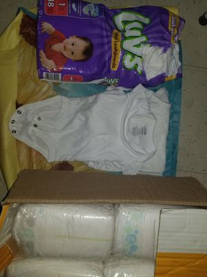 Diapers and onesies for Sale in Lancaster, OH