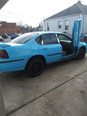 This car has over 20,000 into it needs new engine is lifted for 30s new paint job tear grill chrome package for Sale in Detroit, MI