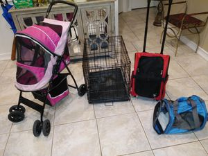 Dog stroller, Cage(17in. w x 24in. long x 19in. tall), Dog Red Backpack carrier, Blue carrier (TAKE ALL $120) for Sale in Tampa, FL