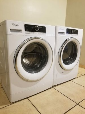 Whirlpool 2.3-cu ft High Efficiency Stackable Front-Load Washer and Whirlpool 4.3-cu ft Stackable Ventless Electric Dryer for Sale in Glendale, AZ