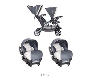 Baby trend 5 point harness double stroller with car seats and bases for Sale in Dearborn, MI
