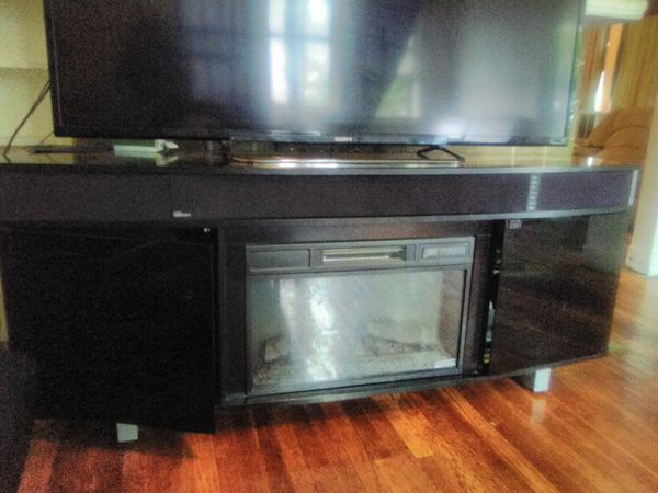 Fire place/surround sysy/tv stand. It holds up to 80 inch tv
