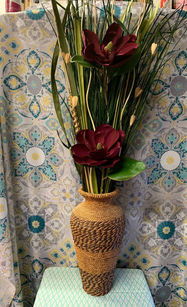 Beautiful tall wicker vase with magnolia flowers