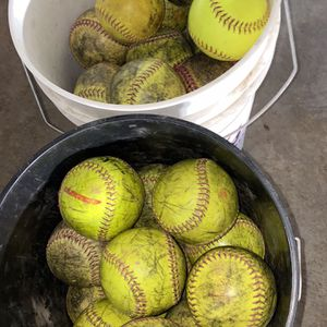 "12"" Fast pitch Softballs 53 Total In 2 Buckets. Will Add 1 Bucket Of 21 White Softballs If You Pay Full Price. for Sale in Rancho Cucamonga, CA"