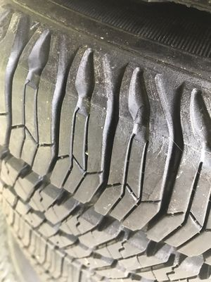 Set of 5 jeep stock tires and rims for Sale in Hudson, NH