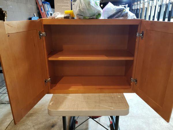 2 kitchen cabinets