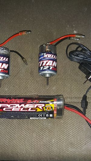 2 Traxxas titan 12t 550 motors, and a Traxxas 8.4v 3000max battery with charger. for Sale in Grand Rapids, MI