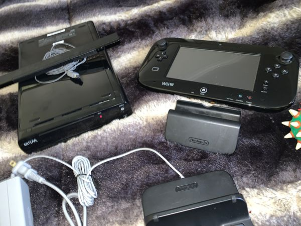 Wii U with remotes, games Nintendo accessories