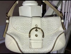 Gently used authentic white logo coach hand bag purse w/ adjustable strap for Sale in St. Petersburg, FL