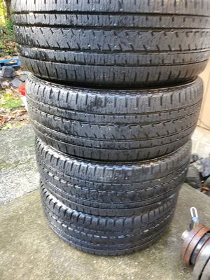 A complete set of high quality Bridgestone Duelers 275/55r20 85-90% tread for Sale in Bremerton, WA