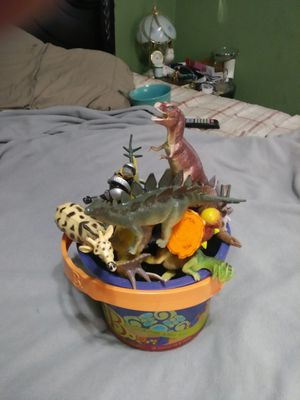 Small bucket of dinosaurs in toys for Sale in Ontario, CA
