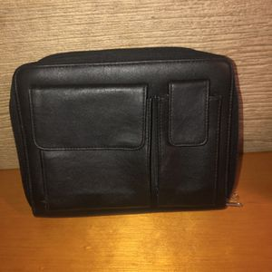 Black leather case/binder/wallet/planner with two zip closures and outside Velcro compartments. There's a place with 6 rings to put papers or planner for Sale in Saint Albans, WV