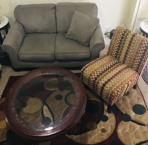 Living room set sofa with chair 5x7 rug and coffee table smoke pet free still available for pick up in Gaithersburg md20877 for Sale in Gaithersburg, MD