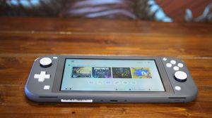 Nintendo Switch Lite - Gray w/Zelda breath of the wild for Sale in Lakewood, CO