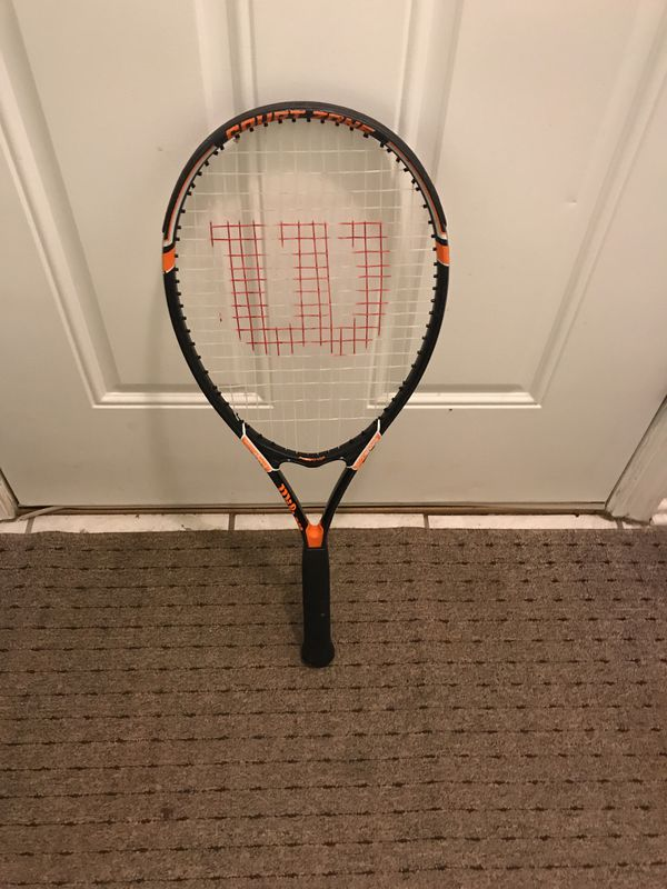 Used Wilson tennis racket.
