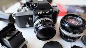Nikon F2 Photomic film camera with waist viewfinder and 2 lenses for Sale in Tampa, FL