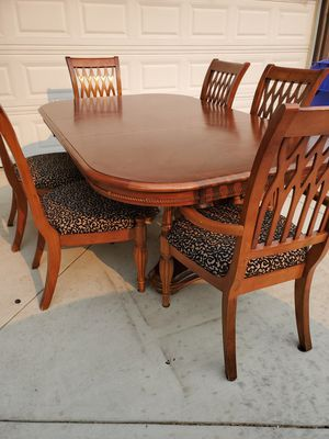 7 piece All Wood Dining table with 6 chairs 4ft x 8ft but you can make it smaller By removing for Sale in Montclair, CA