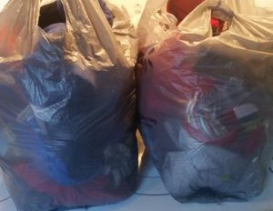 2 Bags of Mixed Clothes for Kids and Adults for 30$ Firm for Sale in Houston, TX