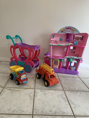 Girls Shopkin Super Mall, girls tea party push cart with removable trays, vtech drop and go dump truck and fire truck for Sale in Fort Lauderdale, FL