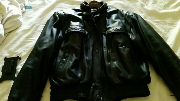 Men's med to large first gear motorcycle leather jacket.made by hein gericke.