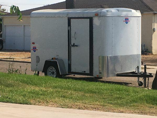 Wells Fargo 6x12 enclosed pull behind trailer