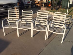 Four vintage aluminum frame vinyl strap pool side patio outdoor furniture chairs for Sale in Norwalk, CA