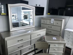 Dresser mirror chest and nightstand from Ashley furniture for Sale in Dallas, TX