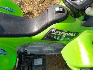 Kids Kawasaki four-wheeler with battery charger for Sale in Laredo, TX