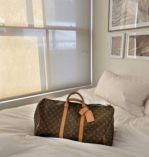 Lv duffle bag for Sale in Snellville, GA
