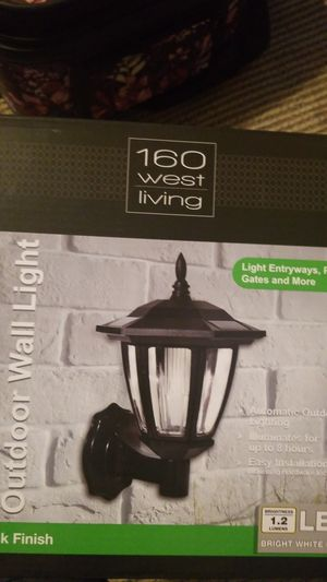 Solor powered outdoor wall light with black finish automatic outdoor light for Sale in Montclair, CA