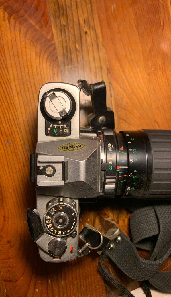 Minolta XG-1 35mm SLR Film Camera with Vivitar 70-210mm lens