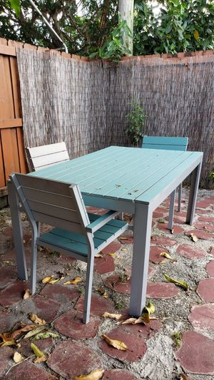 Grey and light blue metal patio table for Sale in Pembroke Pines, FL
