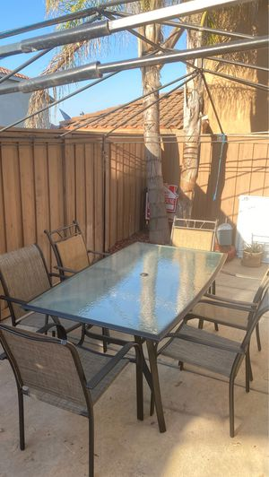 Nice clean good condition outdoor furniture come with table and 6 pics brand new not used chairs $ 200. for Sale in Winchester, CA